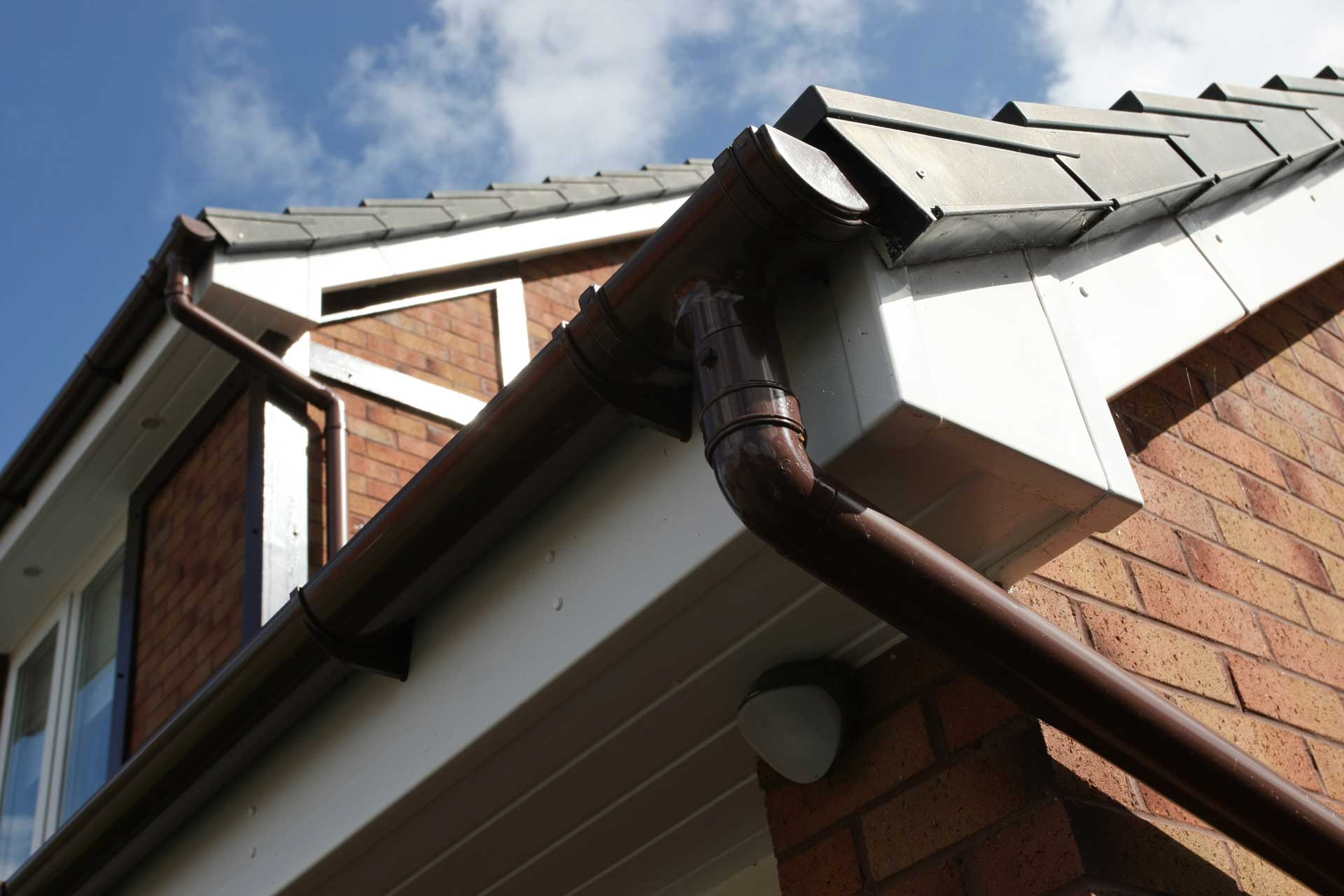 Black guttering with white fascia and soffits